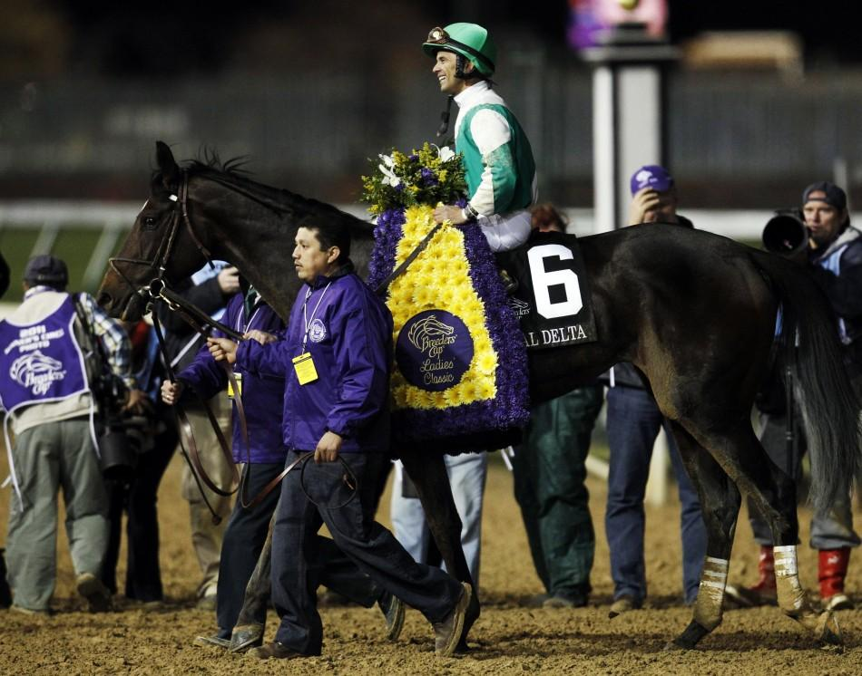 Jockey Jose Lezcano aboard Royal Delta smiles after winning first place in the Ladies Classic during the 2011 Breeders' Cup World Championship horse races at Churchill Downs in Louisville, Kentucky