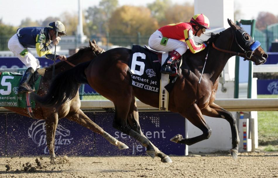 Jockey Rafael Bejarano aboard Secret Circle races to first place past second place jockey Garrett Gomez (L) aboard Shumoos during the Juvenile Sprint during the 2011 Breeders' Cup World Championship horse races at Churchill Downs in Louisville, Kentu