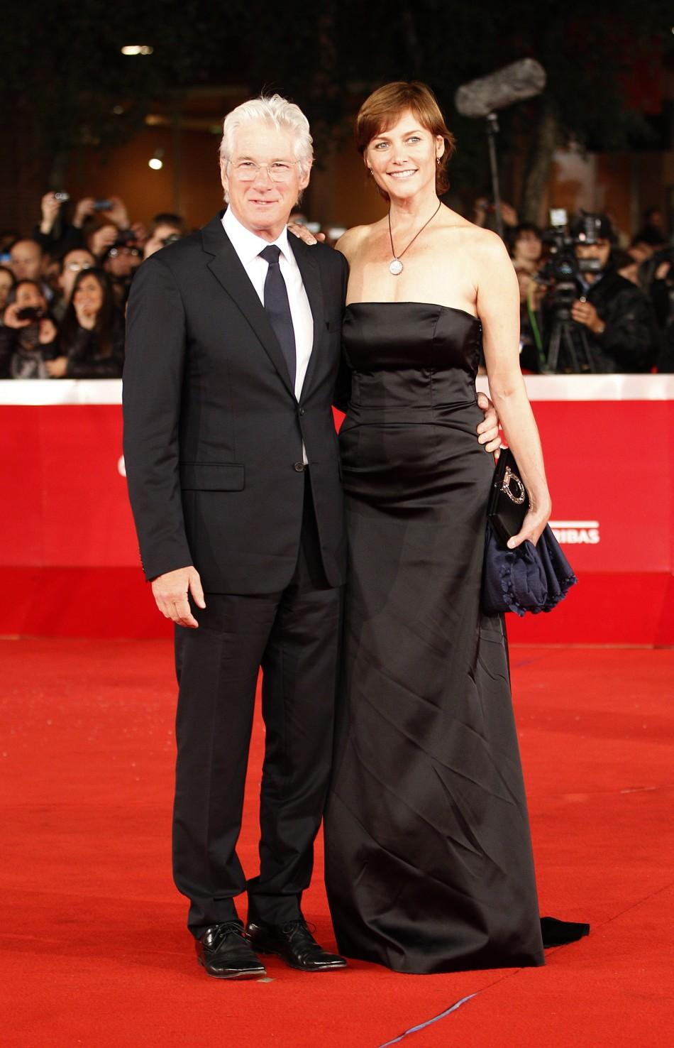 Actor Richard Gere (L) and his wife Carey Lowell pose during a red carpet at the Rome Film Festival
