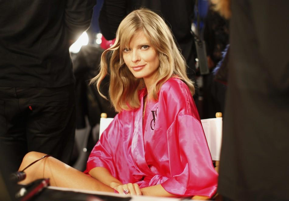 Model Julia Stegner from Germany sits backstage in the hair and makeup area before the 2011 Victoria's Secret Fashion Show in New York November 9, 2011.