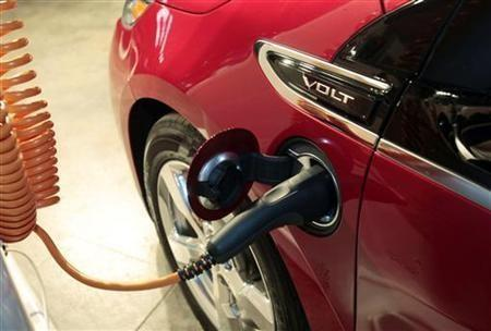 A Chevrolet Volt electric vehicle is plugged into a charging station during a news conference where GM Ventures announced an equity investment in Sunlogics Inc, a global solar energy systems provider specializing in solar project development and installat