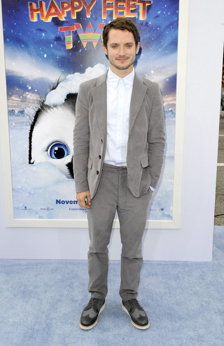 "Actor and voice of Mumble, Elijah Wood, arrives at the premiere of ""Happy Feet Two"" in the Hollywood area of Los Angeles, California"