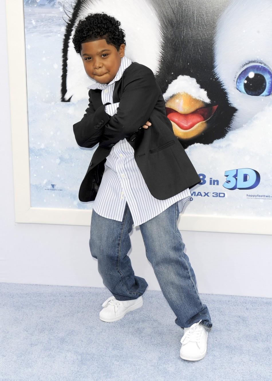 "Actor and voice of Atticus, Benjamin ""Lil P-Nut"" Flores Jr. arrives at the premiere of ""Happy Feet Two"" in the Hollywood area of Los Angeles, California"