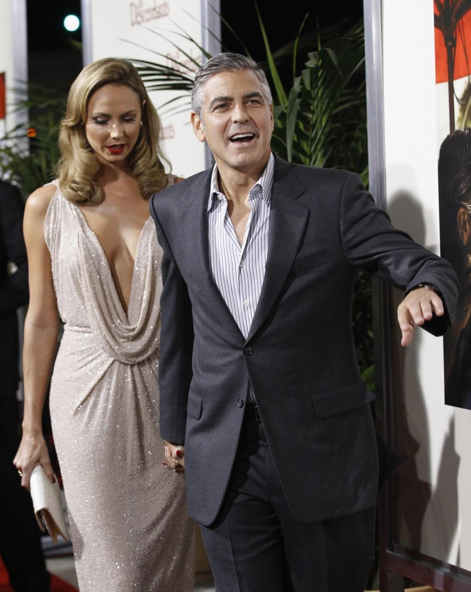"Cast member George Clooney and actress Stacy Keibler arrive at the premiere of ""The Descendants"" at the Samuel Goldwyn Theater in Beverly Hills, California"
