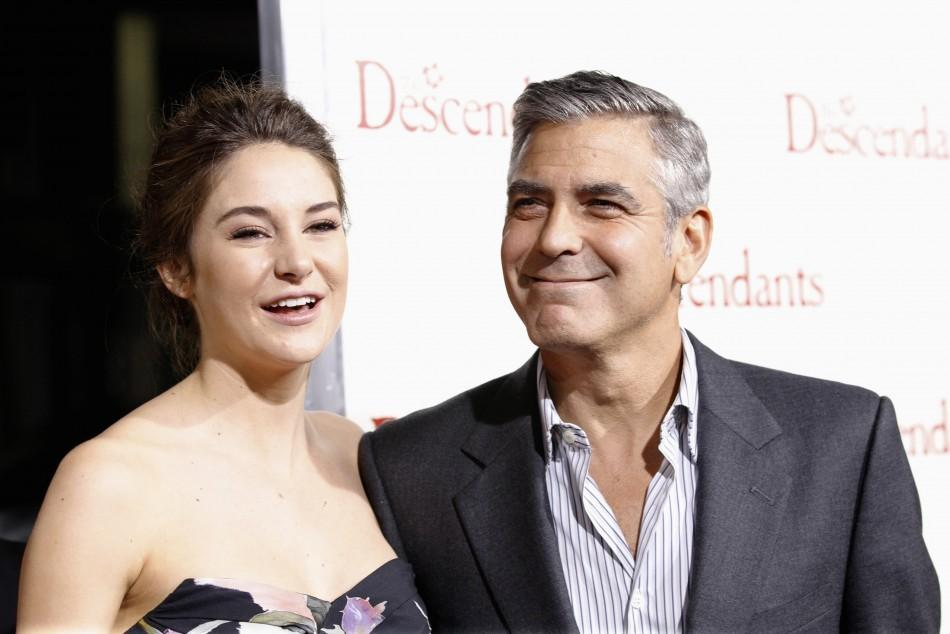 "Cast members George Clooney and Shailene Woodley pose at the premiere of ""The Descendants"" at the Samuel Goldwyn Theater in Beverly Hills, California"