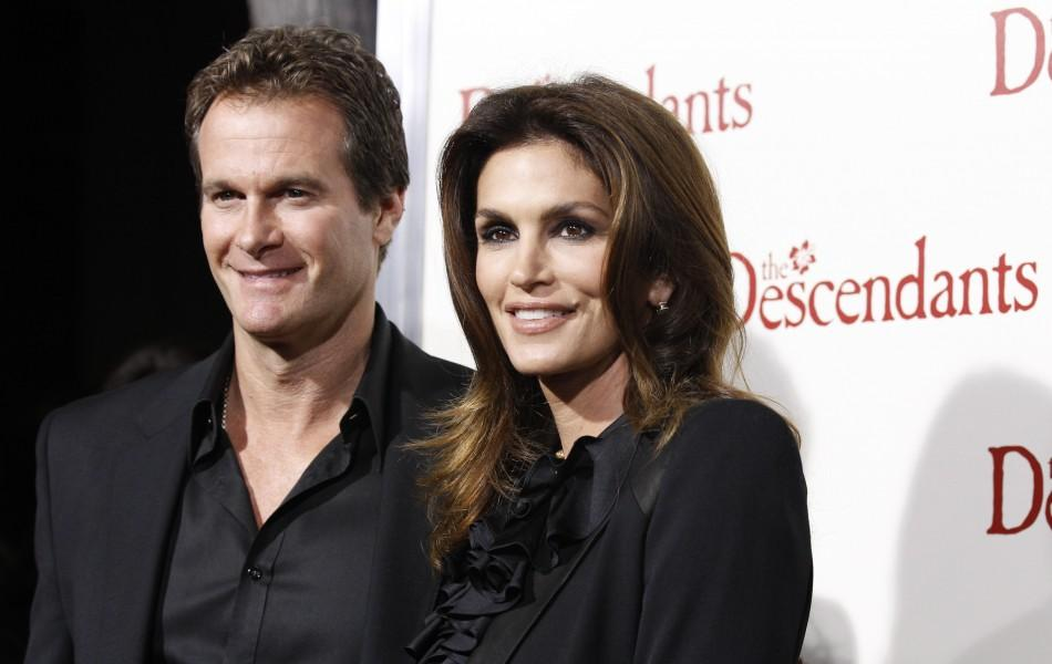 "Model Cindy Crawford and her husband Rande Gerber pose at the premiere of ""The Descendants"" at the Samuel Goldwyn theatre in Beverly Hills, California"
