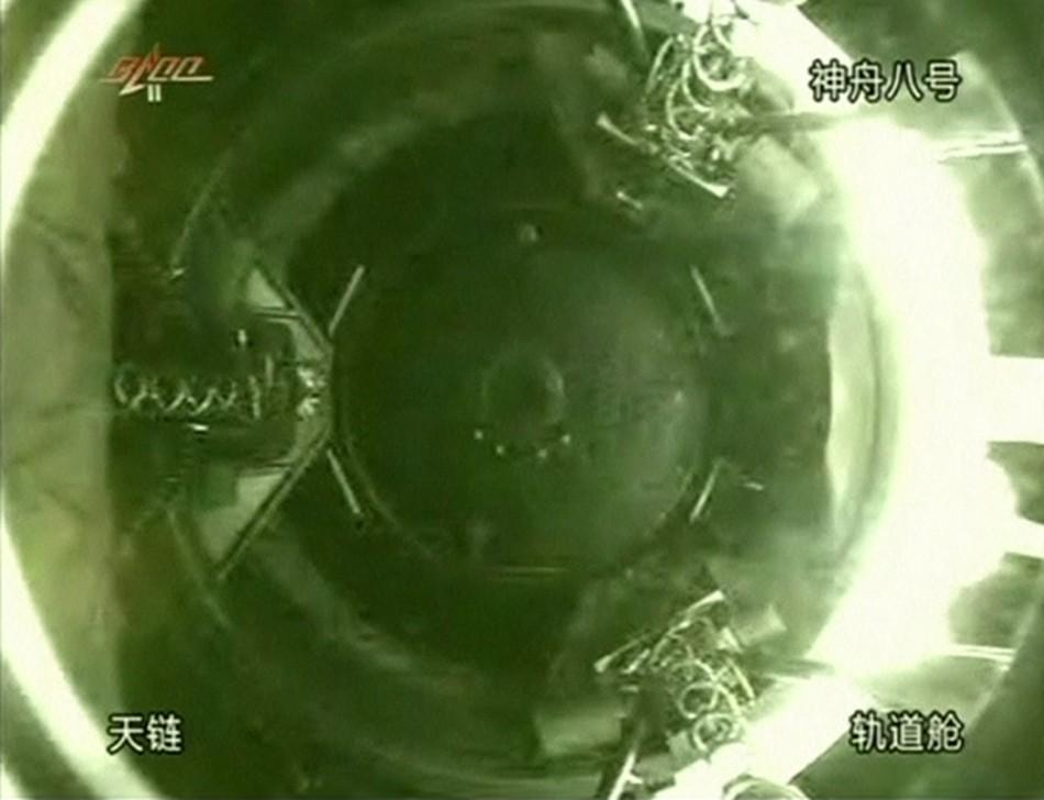 A monitoring screen at the Beijing Aerospace Flight Control Center shows China's Tiangong (Heavenly Palace) 1 module as seen from the Shenzhou 8 spacecraft after docking.