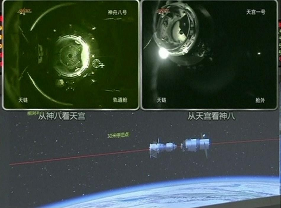 A view of China's Tiangong 1 module just before it docks with the Shenzhou-8 spacecraft on a monitoring screen at the Beijing Aerospace Flight Control Center.