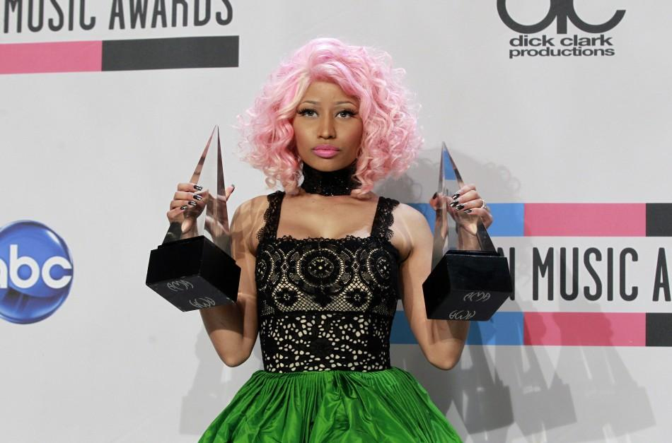 Singer Nicki Minaj poses backstage with her awards for Favorite Rap/Hip Hop Artist and Favorite Rap/Hip Hop Album at the 2011 American Music Awards in Los Angeles November 20, 2011