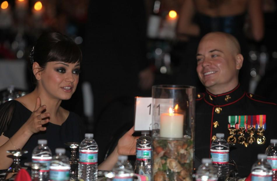 Sergeant Moore and his guest, actress Kunis, attend 236th Marine Corps birthday ball for 3rd Battalion, 2nd Marine Regiment, 2nd Marine Division in Greenville