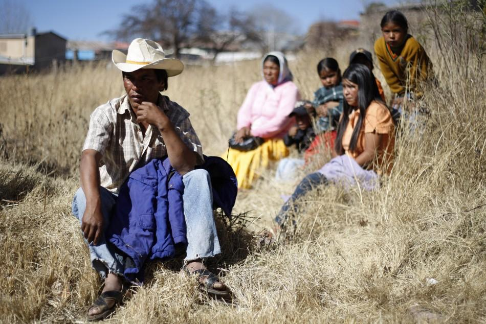 A Tarahumara Indigenous family sits together in Guachochi