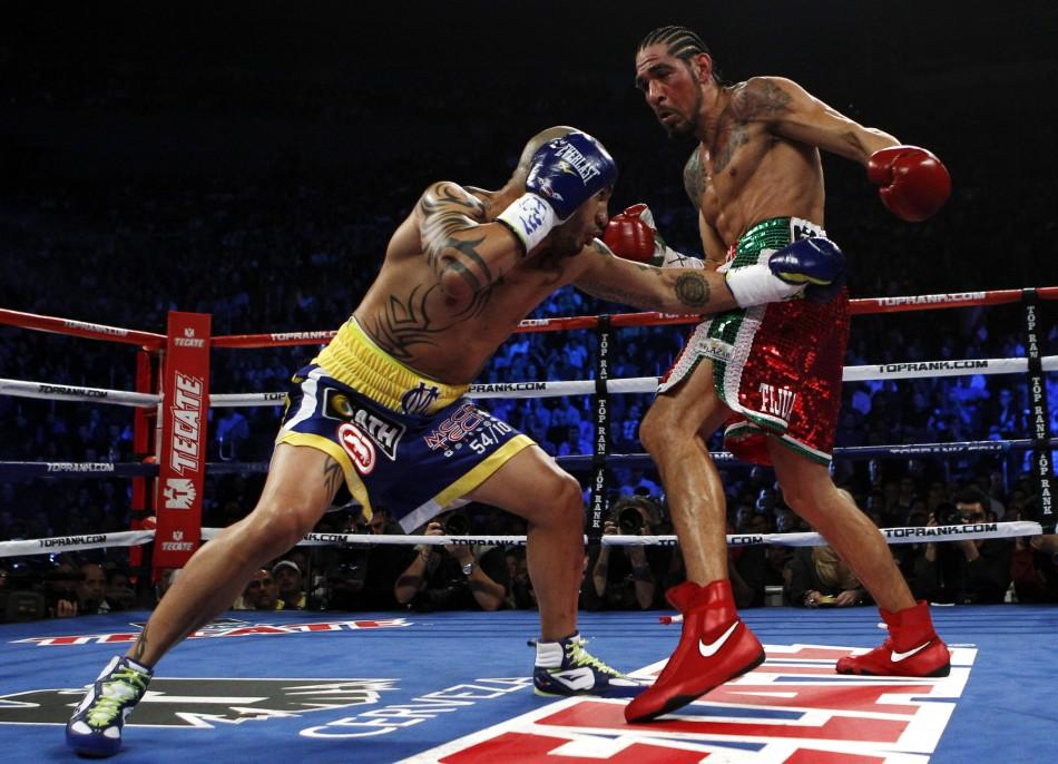 Cotto of Puerto Rico battles Margarito of Mexico during their WBA World Junior Middleweight championship boxing match at New York