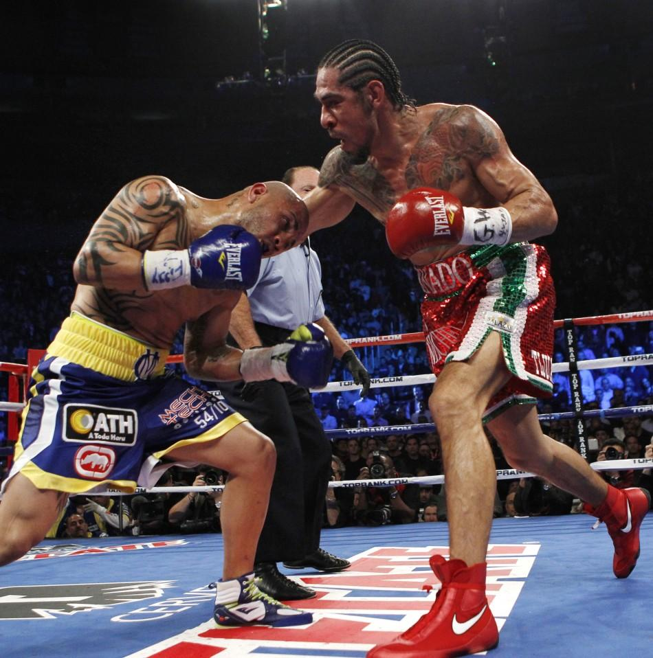 Miguel Cotto battles Antonio Margarito during their WBA Junior Middleweight Championship boxing match in New York