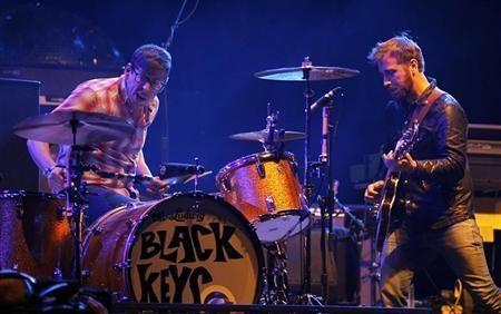 The Black Keys guitarist Dan Auerbach looks over at drummer Patrick Carney as they play on the main stage at the Coachella Valley Music & Arts Festival in Indio, California