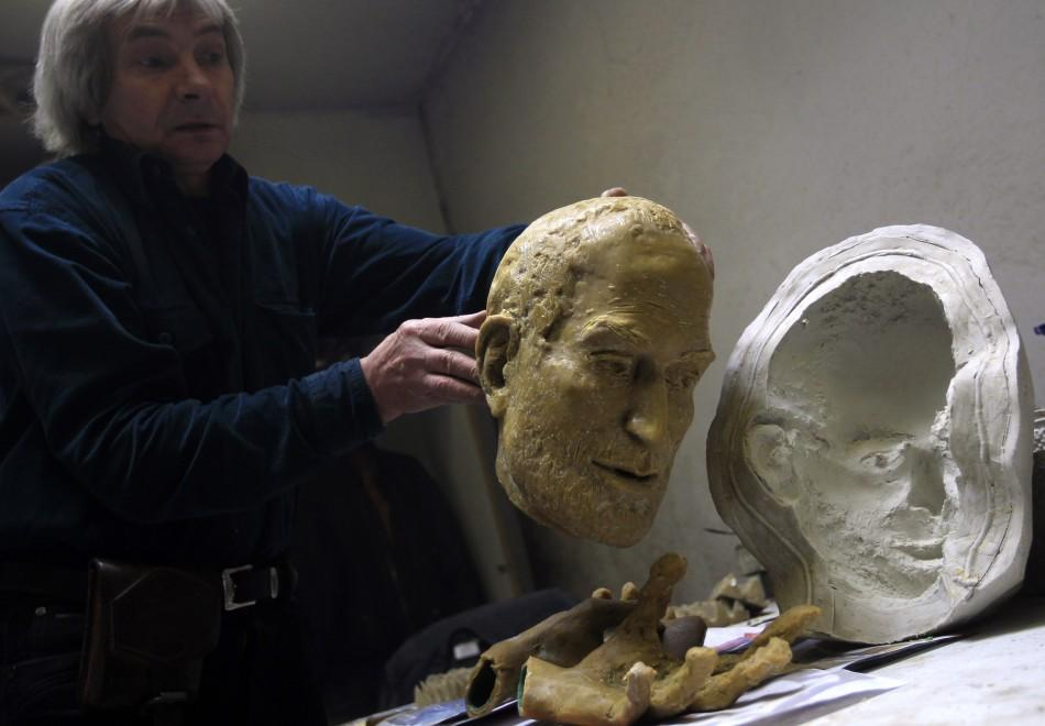 Hungarian sculptor Erno Toth works on a wax model for a new bronze statue of late Apple co-founder Steve Jobs in Budapest