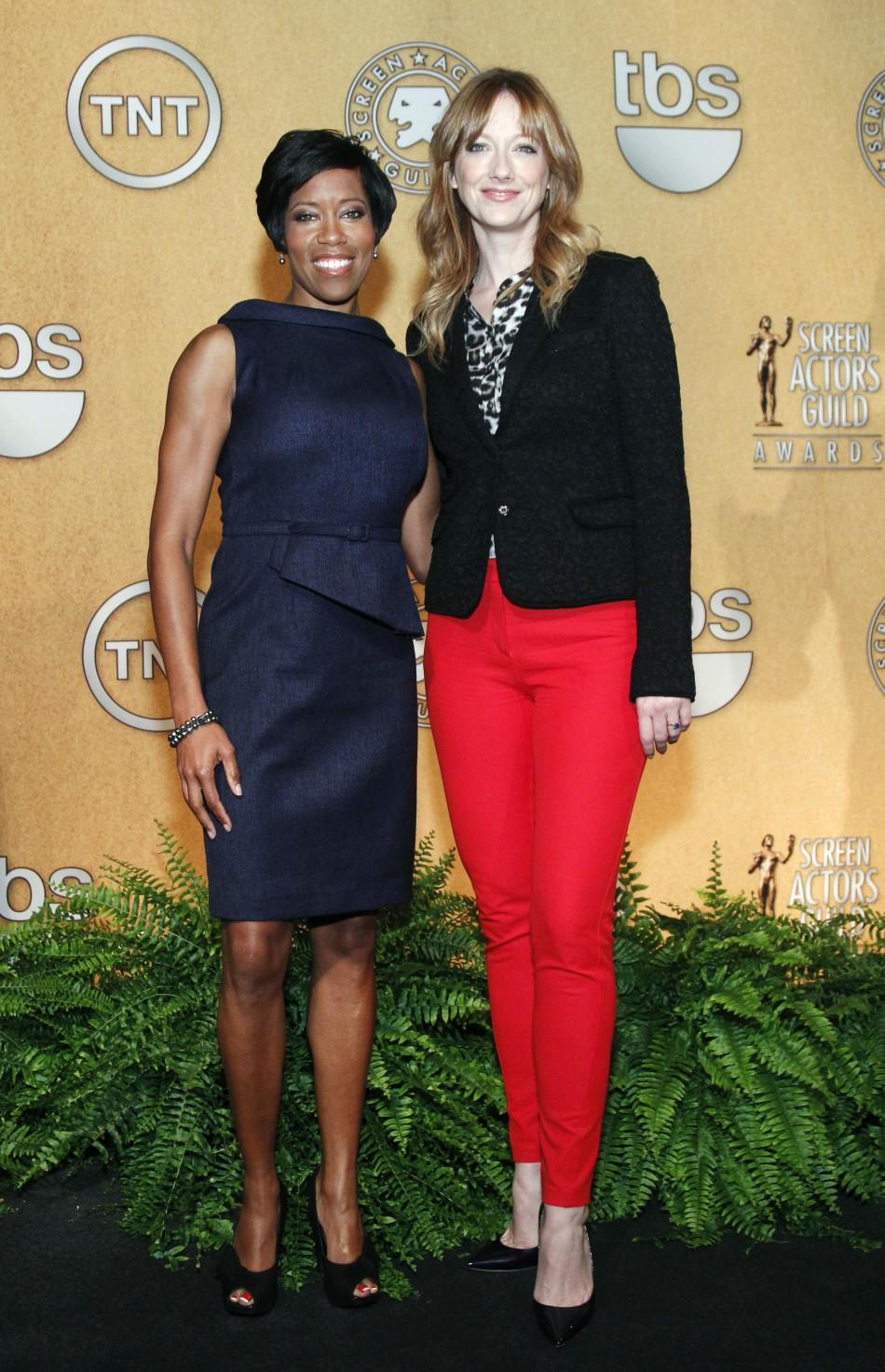 Actresses Regina King (L) and Judy Greer (R) pose together after announcing nominees for the 18th Annual Screen Actors Guild Awards in West Hollywood, California