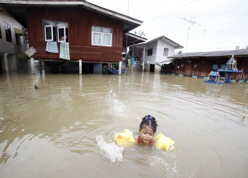 Child swimming in flood water