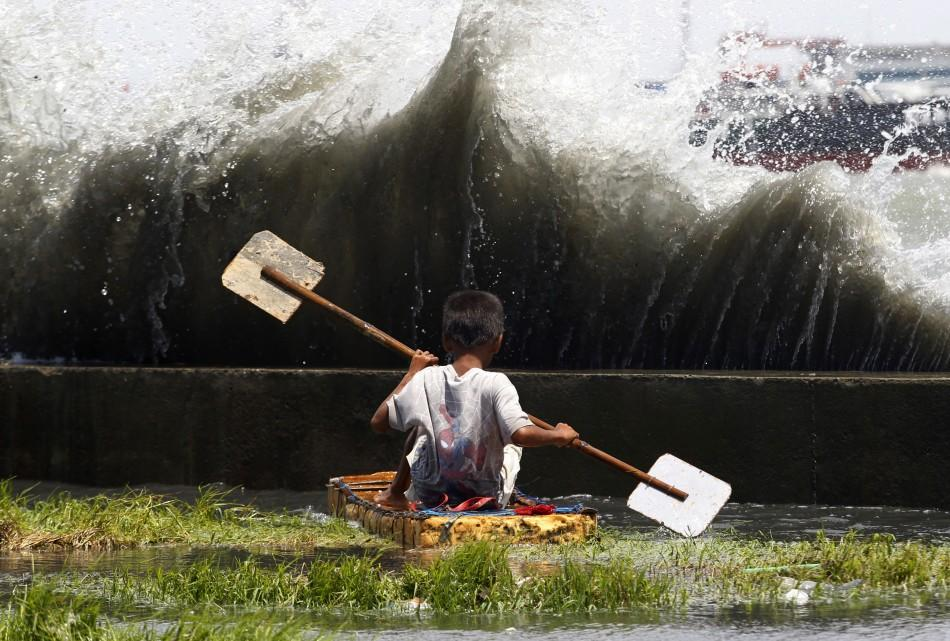 Filipino boy with makeshift boat