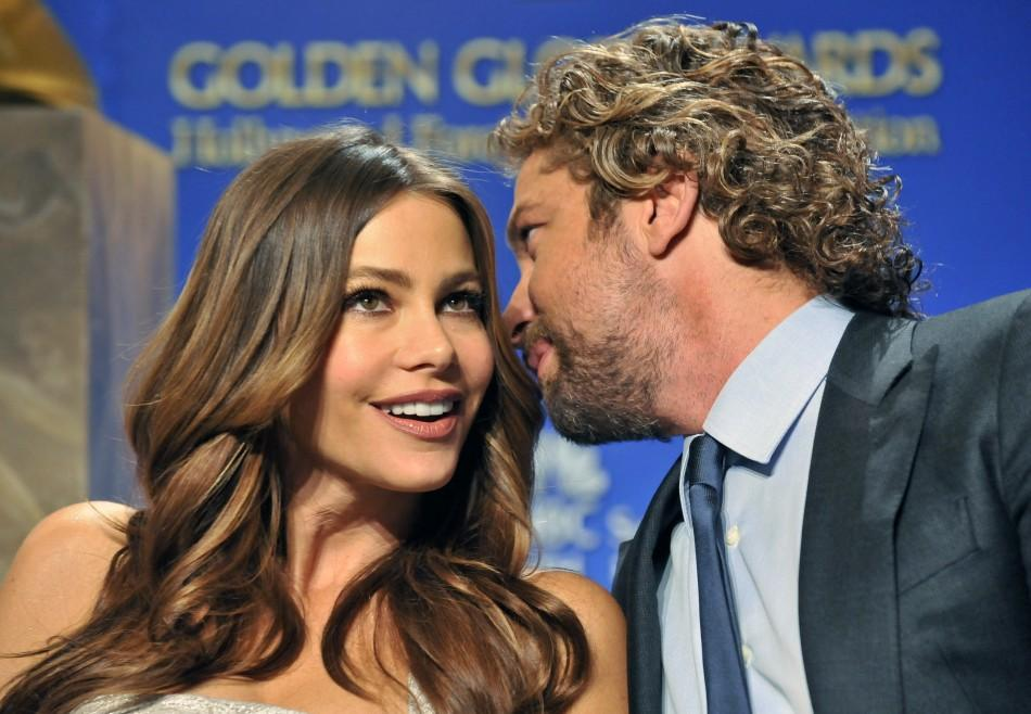 Actors Sofia Vergara (L) and Gerard Butler (R) talk during the nominations announcement for the 69th Annual Golden Globe Awards in the Beverly Hills, California