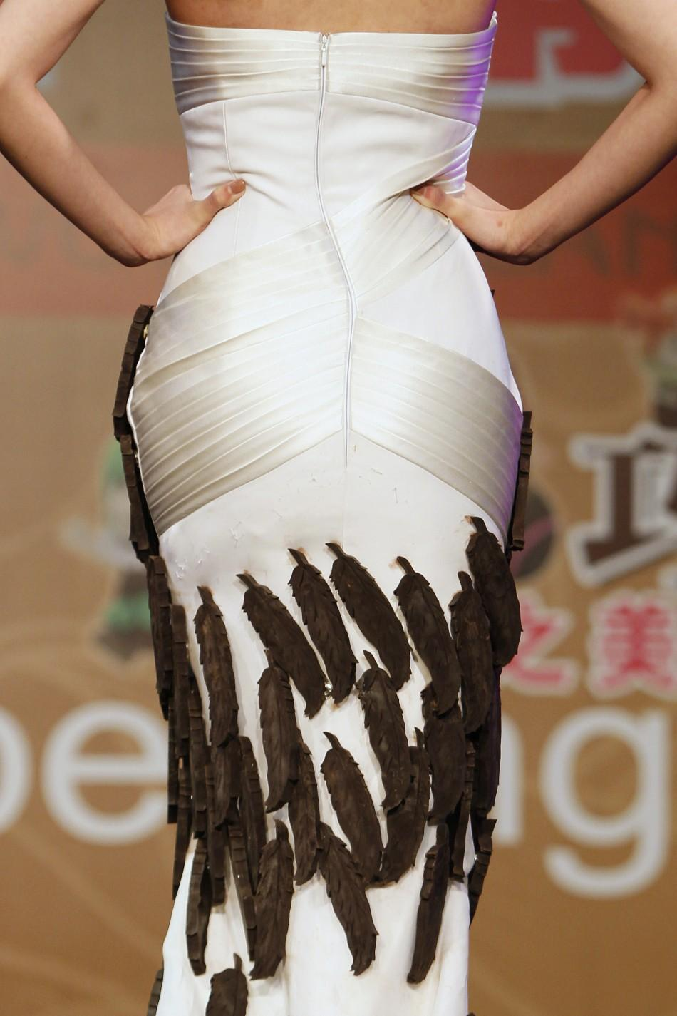 A model presents a creation adorned with chocolate feathers during a chocolate fashion show of the World Chocolate Wonderland in Shanghai December 15, 2011.