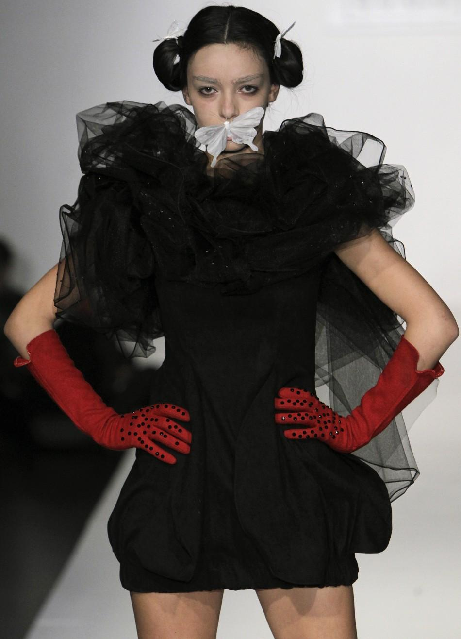 A model presents a creation by Georgian designers Uta and Levani during Tbilisi Fashion Week November 27, 2011.