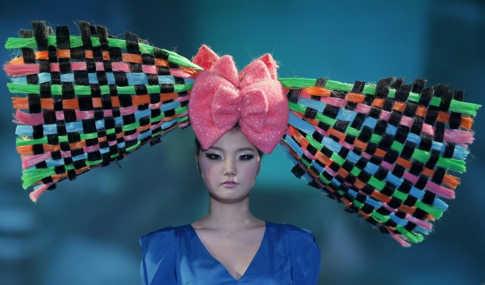 A model presents a creation during the 2012 Korea Hair Collection in Seoul December 6, 2011.