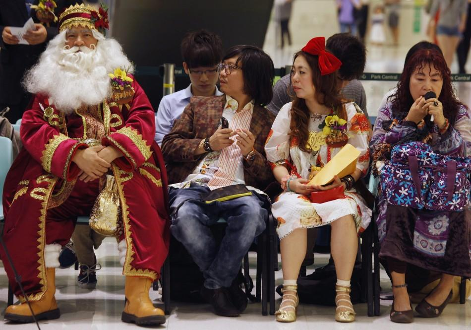 Santa Jim (L), winner of the 2009 Santa Claus Winter Games, sits beside other guests during the Hong Kong round of the Santa Claus Winter Games at a shopping mall in Hong Kong November 2, 2011. Hong Kong won the championship in 2009 and came in third in 2