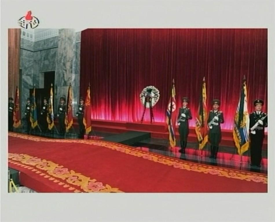 Military guards of honour of the Korean People's Army and the Worker-Peasant Red Guards stand at attention as former North Korean leader Kim Jong-il lies in state at the Kumsusan Memorial Palace in Pyongyang in this still picture taken from video foo