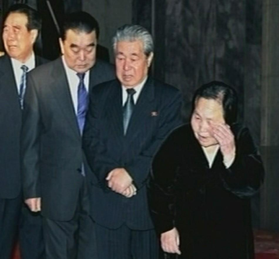 North Korea high level officials (L to R) Kim Phyong Hae, Thae Jong Su, Ju Kyu Chang and Kim Rak Hui mourn as they pay their last respects to former North Korean leader Kim Jong-il lying in state at the Kumsusan Memorial Palace in Pyongyang in this still