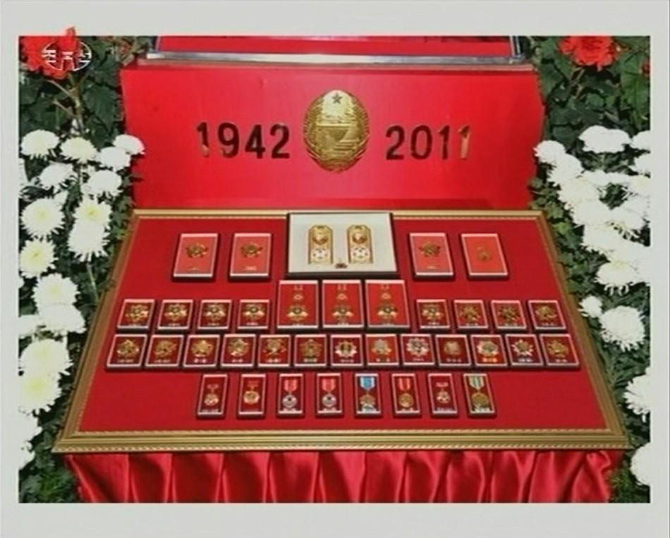 Medals belonging to former North Korean leader Kim Jong-il are displayed as he lies in state at the Kumsusan Memorial Palace in Pyongyang in this still picture taken from video footage of still images aired by KRT (Korean Central TV of the North) December
