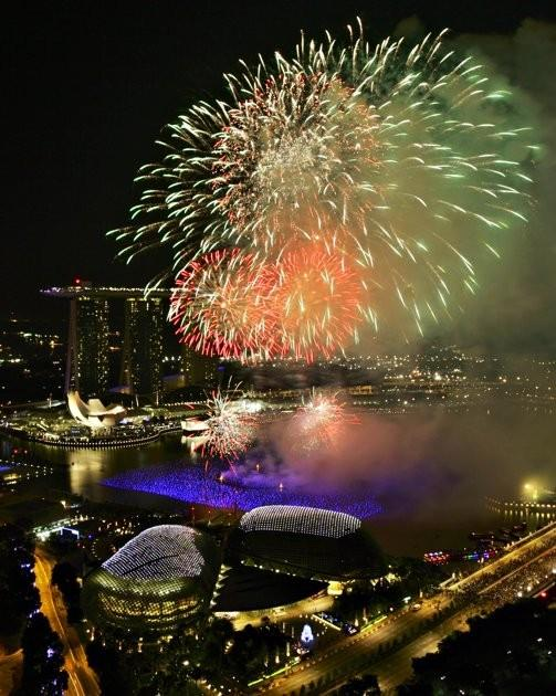 Fireworks explode over Marina Bay during New Year celebrations in Singapore January 1, 2012.