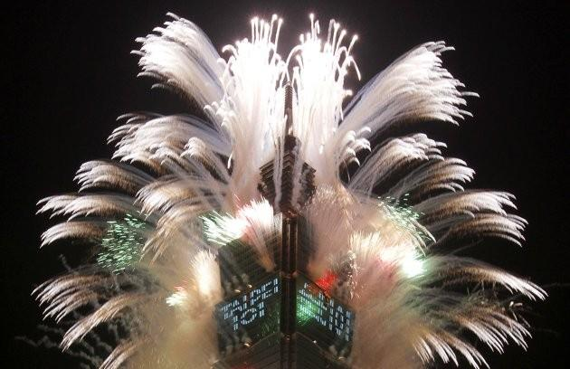 Fireworks explode from Taiwan's tallest skyscraper Taipei 101 during New Year celebrations in Taipei January 1, 2012.