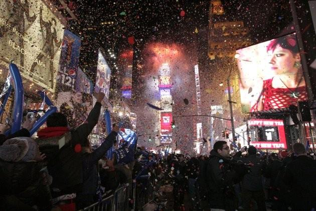 Confetti rains down on revelers at midnight during New Year's Eve celebrations in Times Square in New York, January 1, 2012.