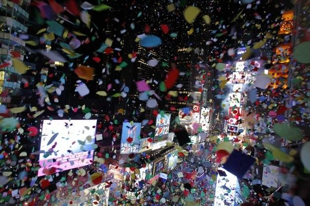 Confetti is dropped on revellers at midnight during New Year's Eve celebrations in Times Square in New York, January 1, 2012.
