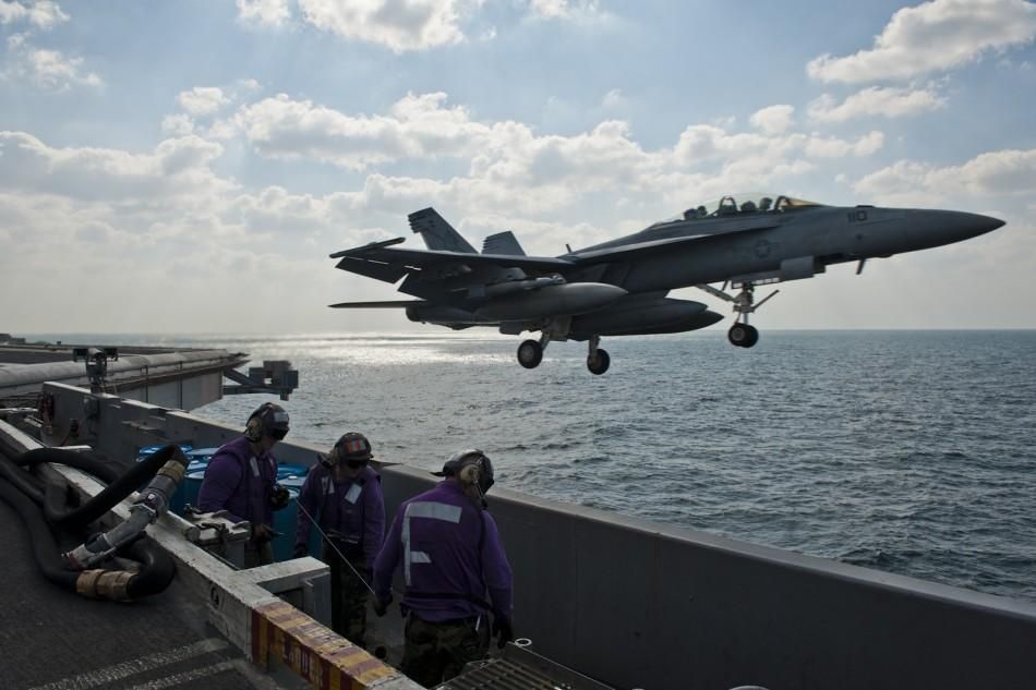 An F/A-18F fighter jet launches off the aircraft carrier USS John C. Stennis during maneuvers in the Arabian Gulf in this U.S. Navy handout photo dated Nov. 23, 2011