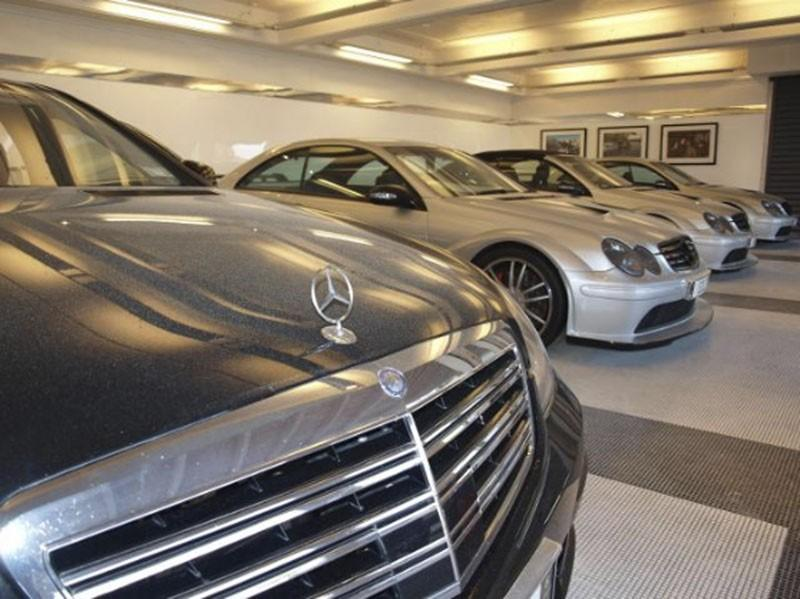 Handout pictures of several Mercedes vehicles at the Auckland residence of Dotcom