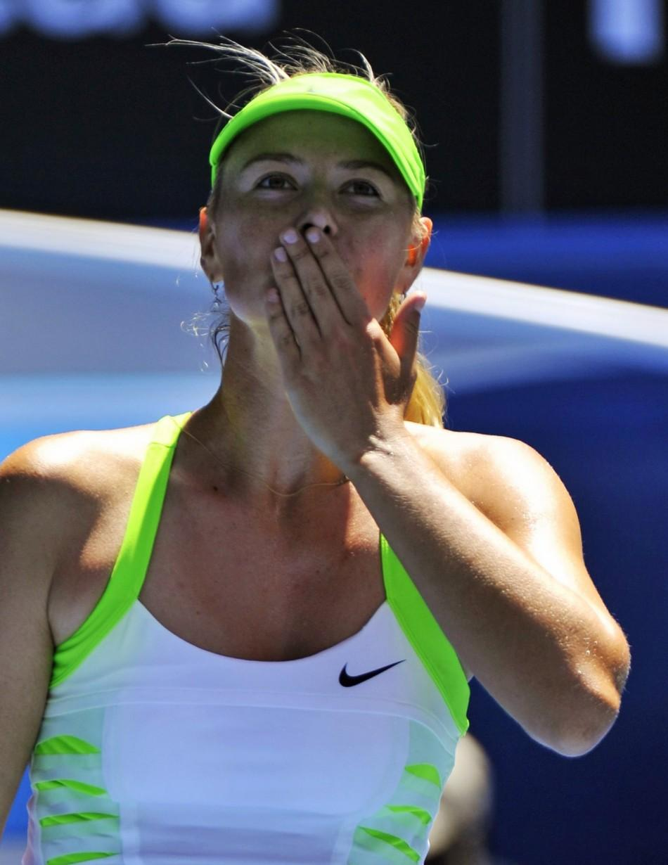 Sharapova of Russia blows a kiss to the crowd after defeating Makarova of Russia in their quarter-finals match at the Australian Open in Melbourne