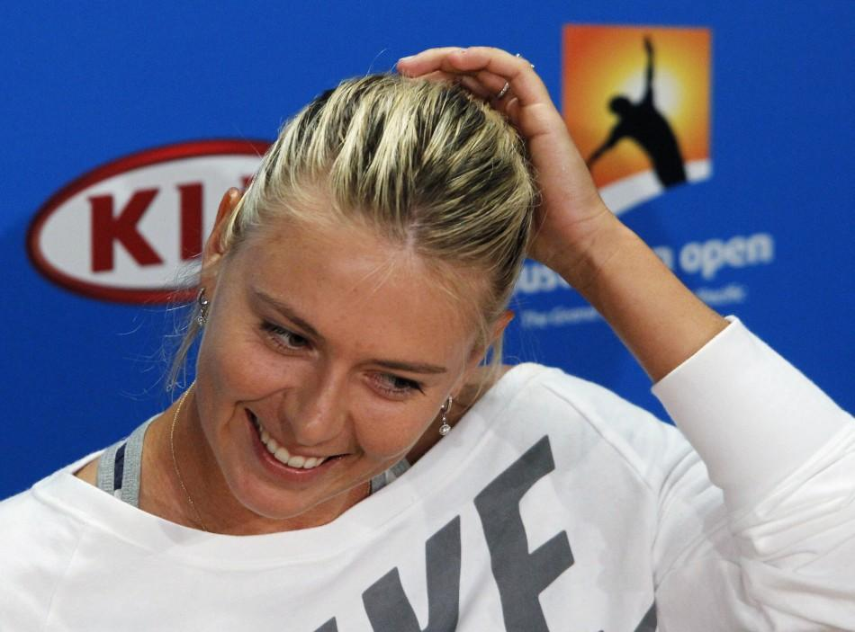 Maria Sharapova of Russia adjusts her hair during a news conference before the Australian Open tennis tournament in Melbourne