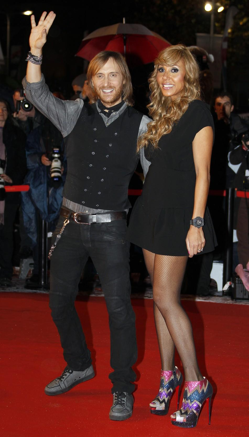 French DJ David Guetta and his wife Cathy arrive at the Cannes festival palace to attend the NRJ Music Awards in Cannes January 28, 2012.