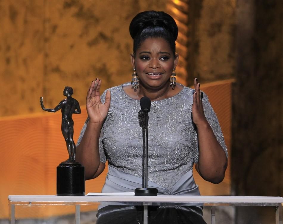 "Actress Octavia Spencer accepts the award for outstanding performance by a female actor in a supporting role for ""The Help"", at the 18th annual Screen Actors Guild Awards in Los Angeles, California January 29, 2012."