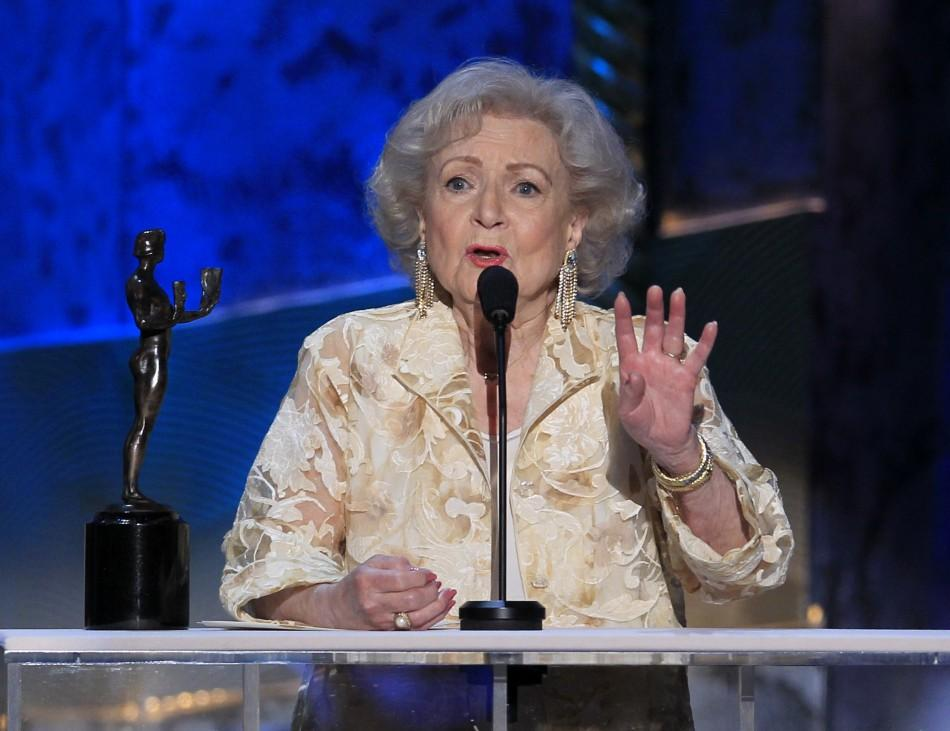 "Actress Betty White accepts the award for outstanding performance by a female actor in a comedy series for ""Hot in Cleveland"", at the 18th annual Screen Actors Guild Awards in Los Angeles, California January 29, 2012."