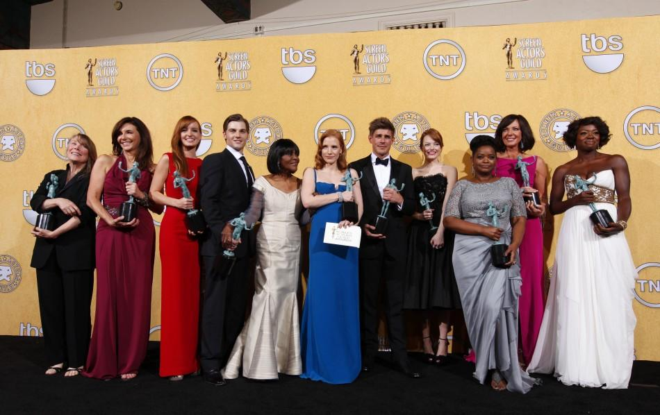 "The cast of ""The Help"" poses for photographs backstage with their awards for outstanding performance by a cast in a motion picture at the 18th annual Screen Actors Guild Awards in Los Angeles, California January 29, 2012."