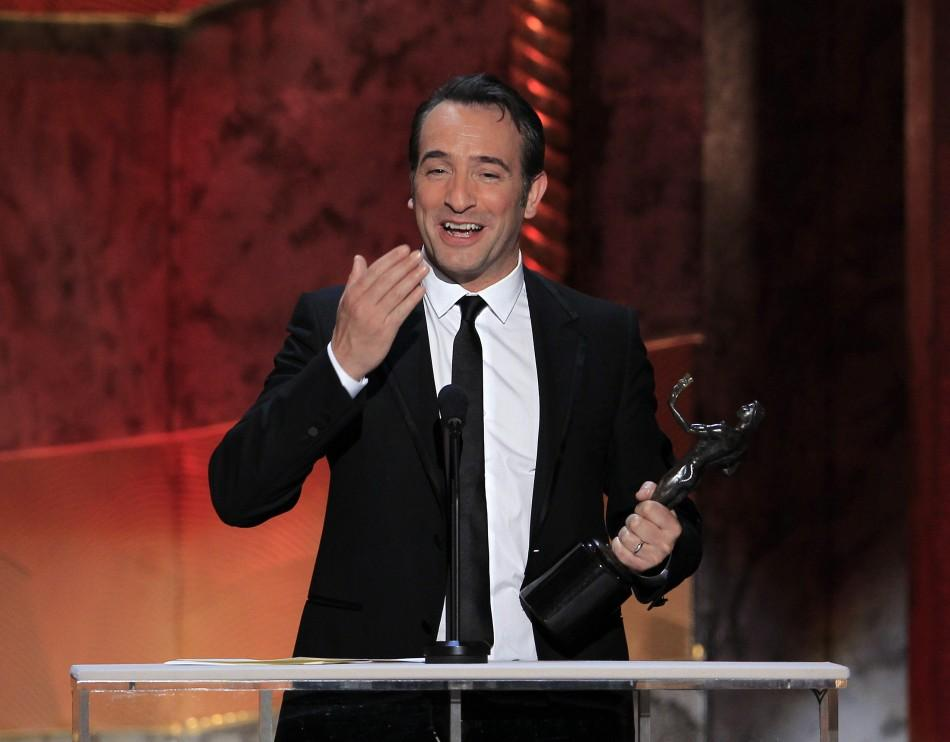 "Actor Jean Dujardin accepts the award for outstanding performance by a male actor in a leading role for ""The Artist"", at the 18th annual Screen Actors Guild Awards in Los Angeles, California January 29, 2012."