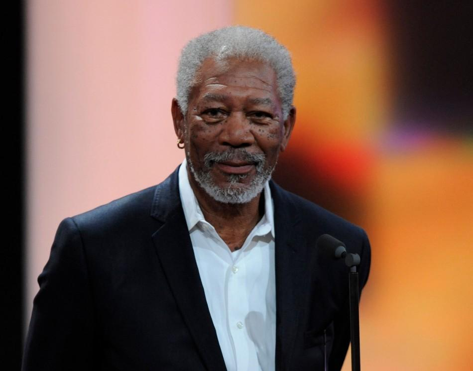 """U.S. actor Morgan Freeman receives his trophy for Category """"International Lifetime Achievement"""" during the 47th Golden Camera award ceremony in Berlin February 4, 2012. The Golden Cameras (Goldene Kamera) are awarded by a popular German TV-magaz"""