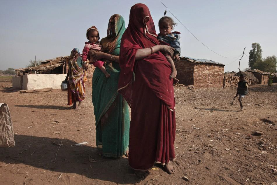 Women of the Sahariya tribe in northwestern India bring their malnourished children to a local clinic