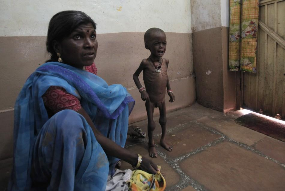 Rajni waits with her mother at the clinic in central India