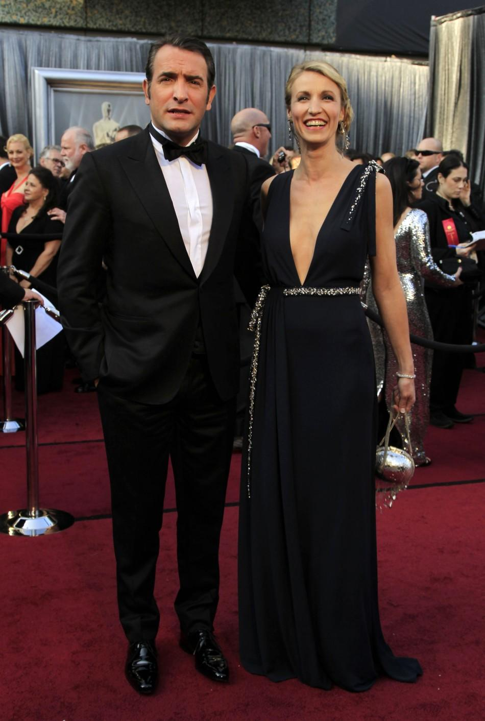 "French actor Jean Dujardin, best actor nominee for his role in ""The Artist"", and his wife Alexandra Lamy arrive at the 84th Academy Awards in Hollywood"