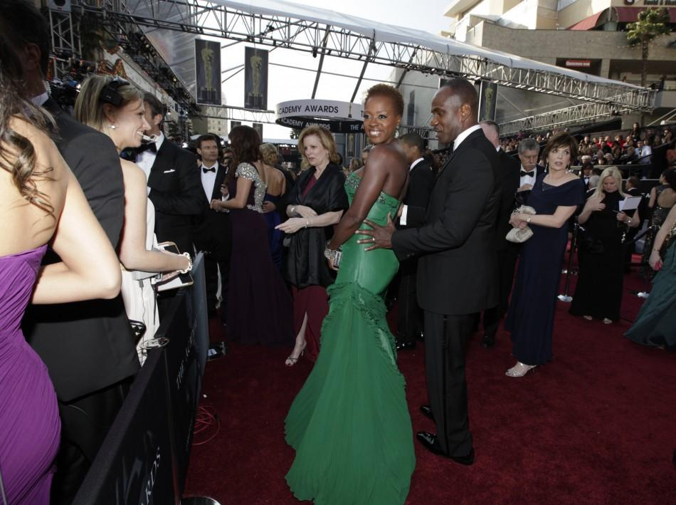 "Viola Davis, best actress nominee for her role in ""The Help"", and her husband Julius Tennon arrive at the 84th Academy Awards"