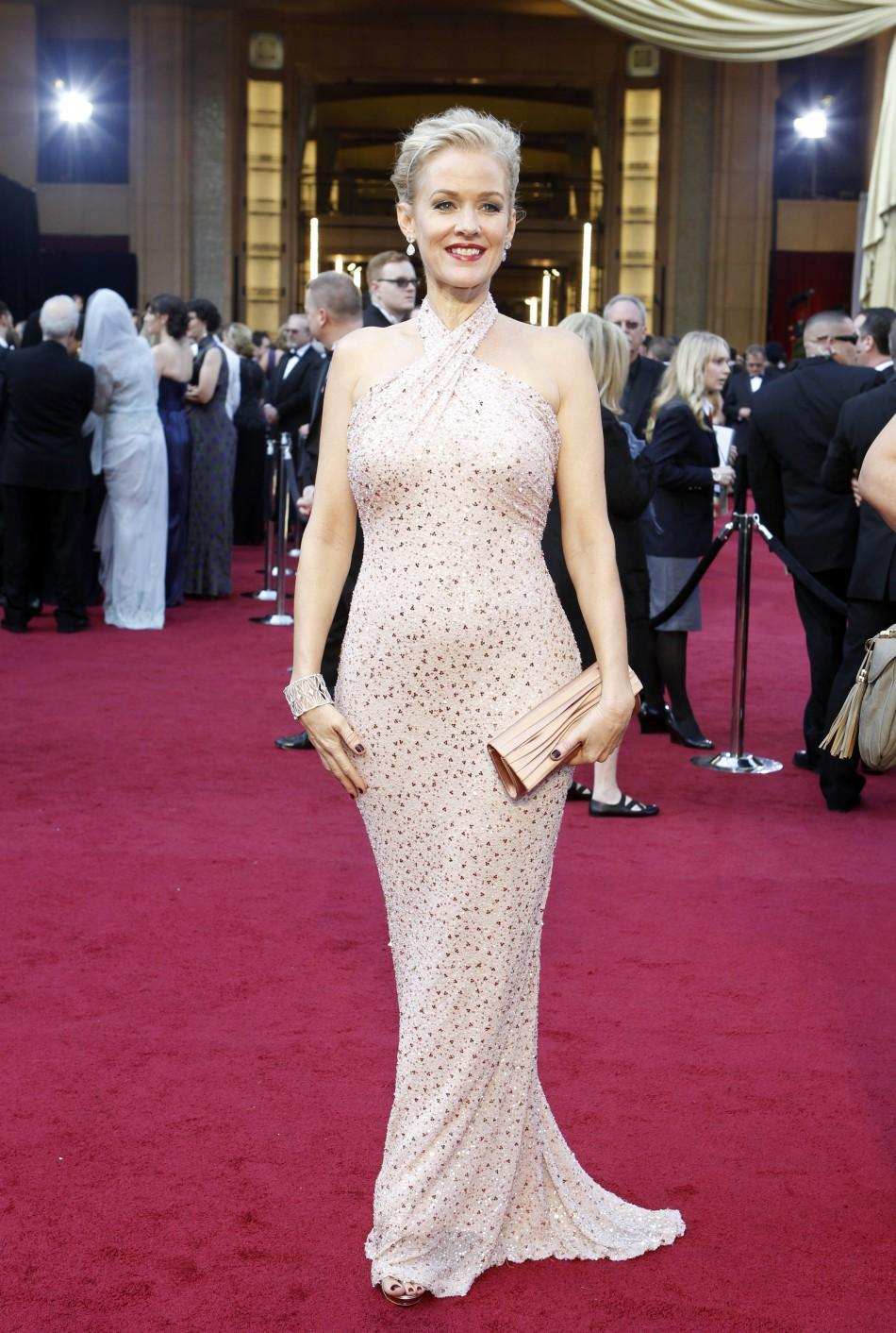 "Actress Penelope Ann Miller from the film ""The Artist"" poses as she arrives at the 84th Academy Awards in Hollywood, California February 26, 2012."