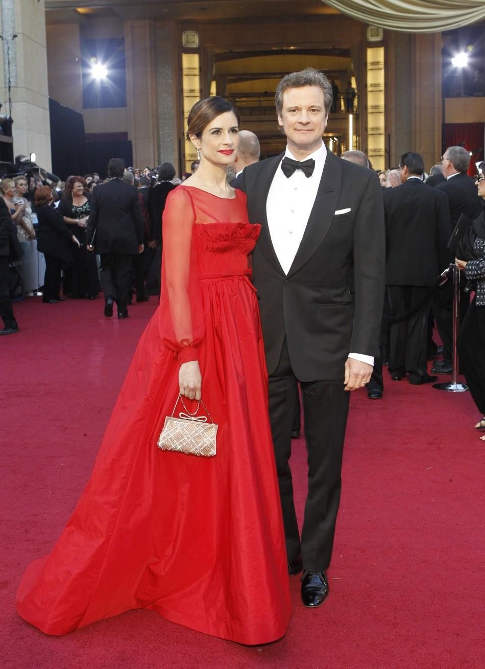 Actor Colin Firth and his wife Livia Giuggioli pose at the 84th Academy Awards in Hollywood, California, February 26, 2012.